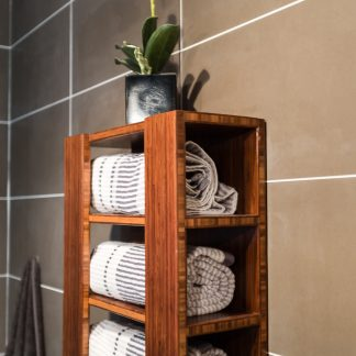 Bamboo towel rack by FATSTICK on elegant floor to ceiling porcelain tile.