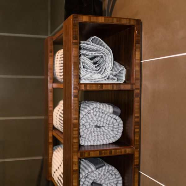 Bamboo towel rack by FATSTICK on a porcelain tile wall.